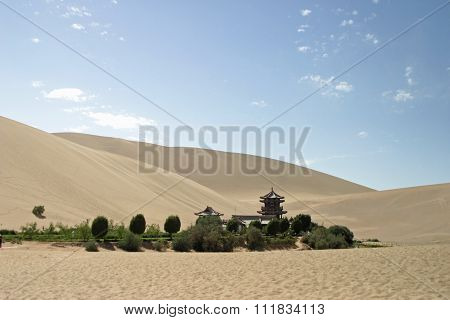 Crescent lake in Mingsha Shan (Echo Sand Mountain) Dunhuang China
