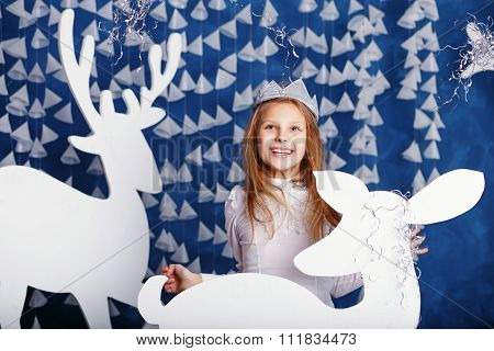 Portrait Of Beautiful Little Girl With Long Blond Hair With Crown