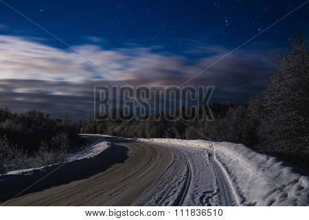 Winter night landscape with the stars and the road