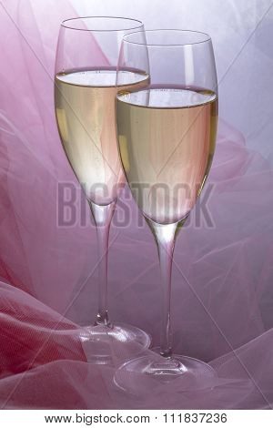 Two Glasses of Champagne with Backlit Tulle Background