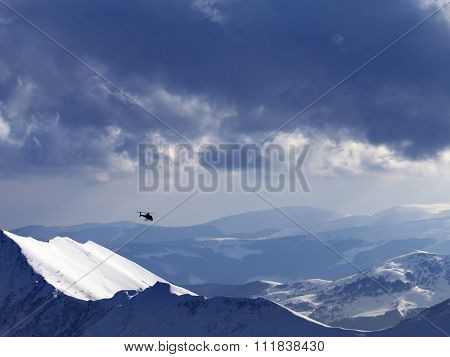 Off-piste Slope For Heliskiing And Helicopter In Evening