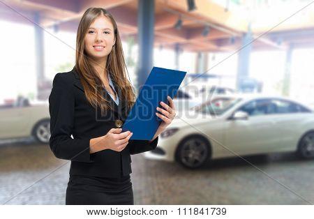 Beautiful car dealer smiling
