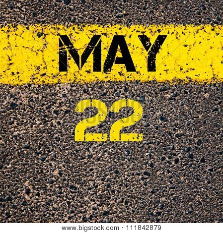 22 May Calendar Day Over Road Marking Yellow Paint Line
