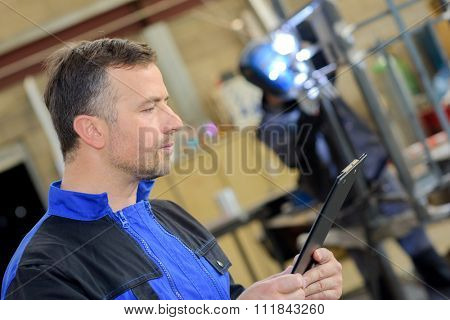 Workman holding a clipboard
