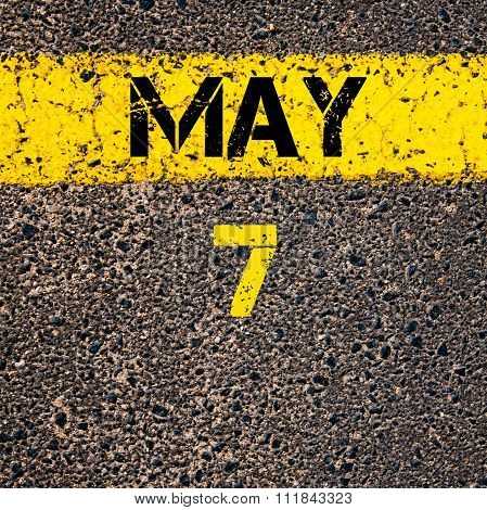 7 May Calendar Day Over Road Marking Yellow Paint Line