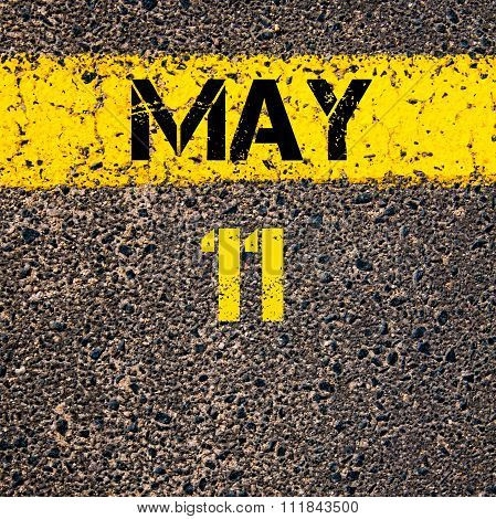 11 May Calendar Day Over Road Marking Yellow Paint Line