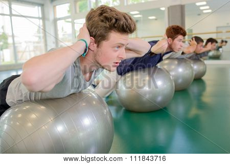 men on their gym ball
