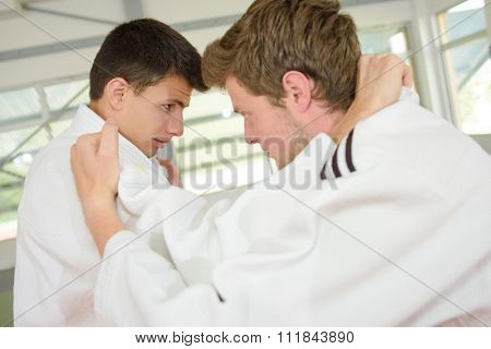 Two young men practicing a martial art