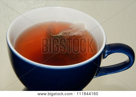 Raspberry herbal tea in coffee mug