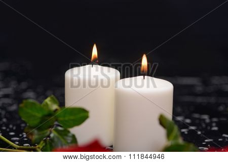 red rose,petals with candle and therapy stones