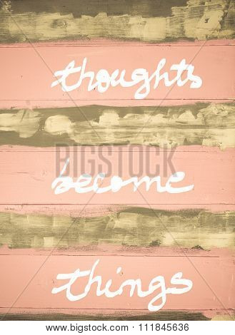Concept Image Of  Thoughts Become Things Motivational Quote Hand Written On Vintage Painted Wooden W