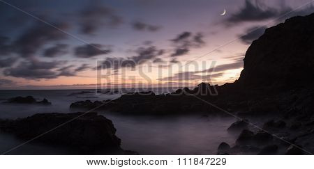 Moonset and sunset at Crescent Bay beach