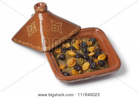 Square tagine with apricots and prunes on white background
