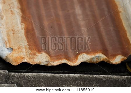 The Damaged And Rusted Metal Sheet Of Roof