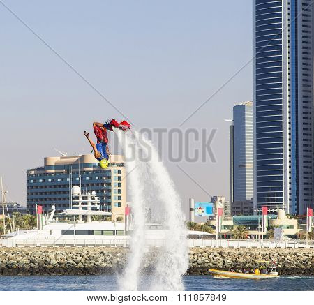 man on flayborde doing flips to compete in extreme sports