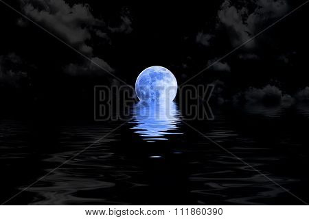 Dark Blue Full Moon In Cloud With Water Reflection Closeup Showing The Details Of The Lunar