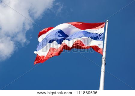 Flying the Thailand flag on pole and blue sky background