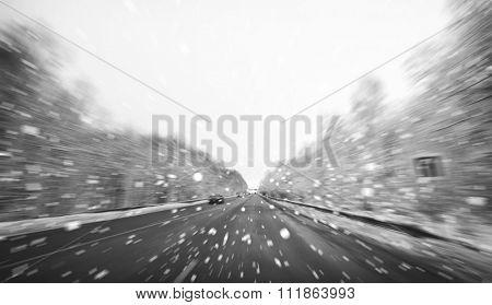 Blurred winter asphalt road