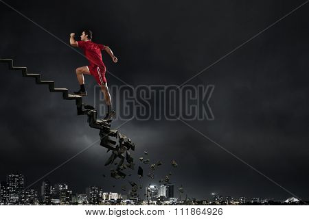 Sports active man running on stone collapsing ladder