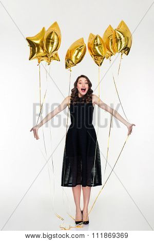 Charming elated happy young curly woman with bright makeup in retro style celebrate her birthday