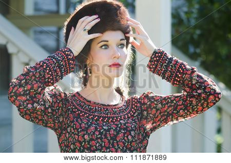 Russian style beauty woman wearing fur Cossack hat and silver ring