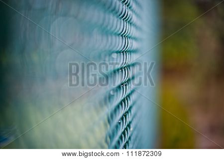 Closeup Of Green Wire Mesh Fence With Selective Focus