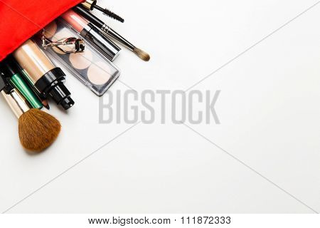 cosmetics, makeup and beauty concept - close up of cosmetic bag with makeup stuff