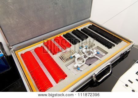 vision, eyesight, optometry, health care and medicine concept - ophthalmologist box with lenses lenses and glasses