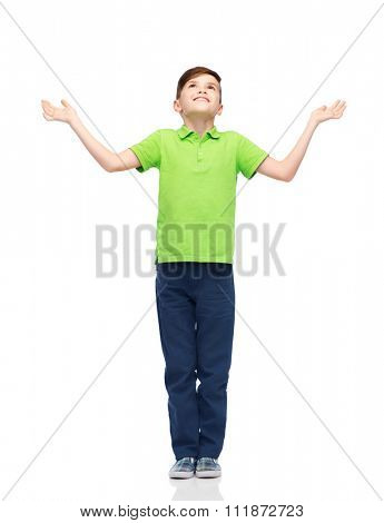 childhood, achievement, gladness and people concept - happy smiling boy in green polo t-shirt raising hands and looking up