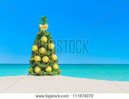 Christmas Tree With Golden Decorations And Tropical Ocean Sandy Beach