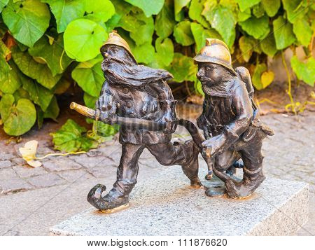 Two dwarf firemen figurines in Wroclaw