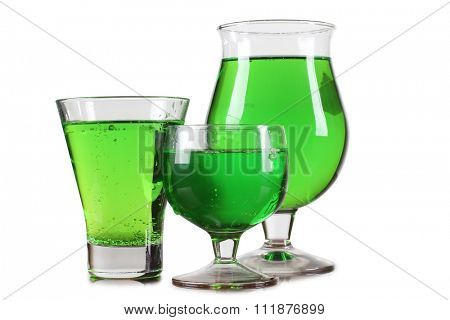 Glass cup with tequila on white background