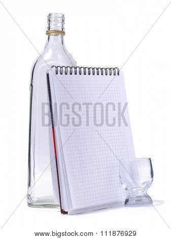 Bottles and blocknote on a white background