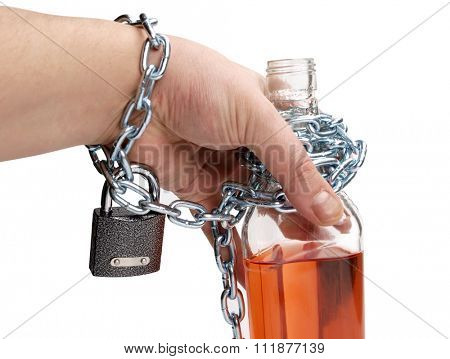 Wineglass of whiskey and metal chain
