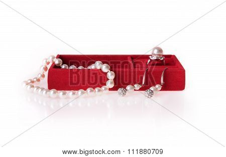 Jewelry box with pearl necklace, ring and ear-rings