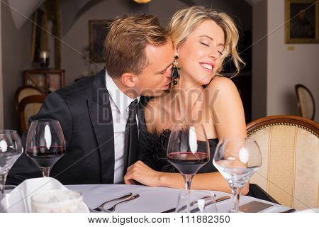 Man kissing female neck