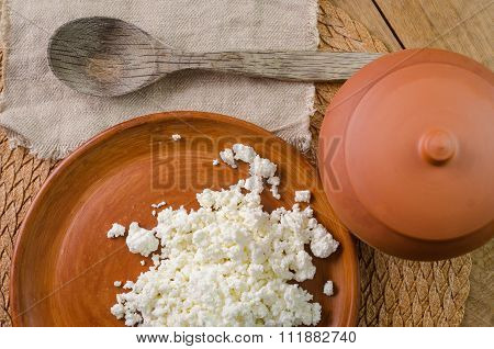 curds on the brown plate