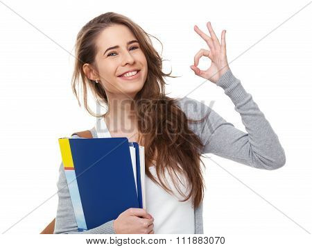 Young Happy Student Showing Ok Sign Isolated On White.