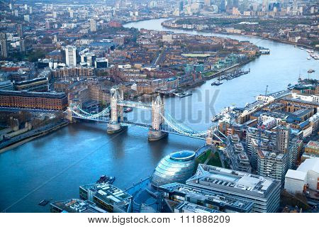City of London panorama at sunset. River Thames, Tower bridge and Canary Wharf in the distance. Aeri