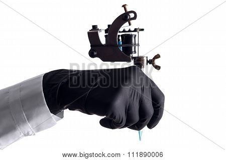 Hand Holding Tattoo Machine