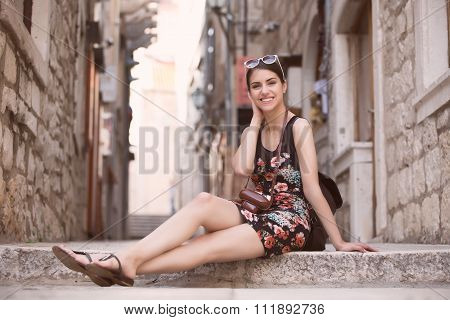 Woman tourist capturing memories.Young woman tourist,nomad,backpacker.Beautiful woman traveling
