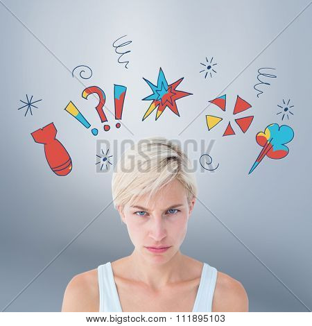 Upset woman looking at camera against grey vignette