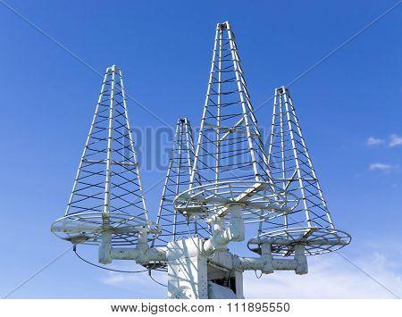 Satellite Antennas On Background Sky