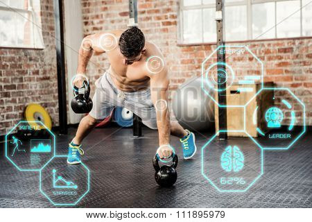 Shirtless man lifting kettlebell against fitness interface