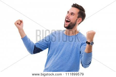 Happy man clenching fists