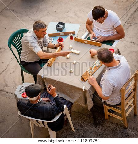 Men Playing Okey
