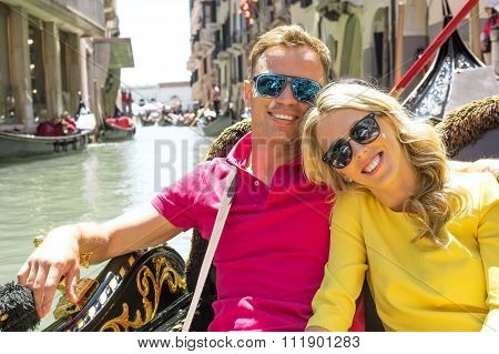 Couple sitting in gondola and smiling