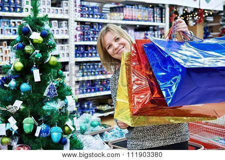 Beautiful Woman With Colorful Bag In Supermarket