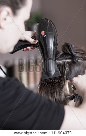 Hairdresser Using Hairdryer