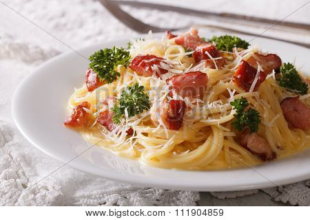 Delicious Pasta Carbonara With Bacon Close-up On A Plate. Horizontal